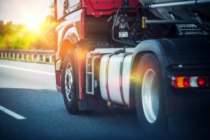 Red Semi Truck Speeding on a Highway thanks to the Dayton CDL attorneys that got his license back.