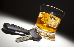 Alcoholic Drink and Car Keys Under Spot Light representing the need for a Dayton DUI attorney.
