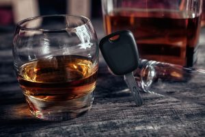 Alcohol drink,car keys and empty glass on bar table for a DUI Lawyer dayton