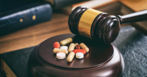 Gavel with pills